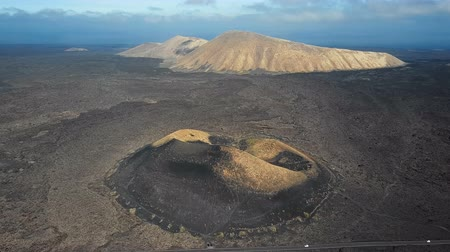 montana : Aerial view of Volcanic valley near Timanfaya National Park and Montana Blanca, Lanzarote, Canary islands, Spain Stock Footage