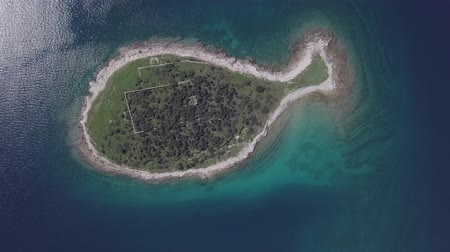 ruins : Top aerial view of small desert fish shaped island Gaz in Brijuni islands, Istria, Croatia. Original untouched LOG format.