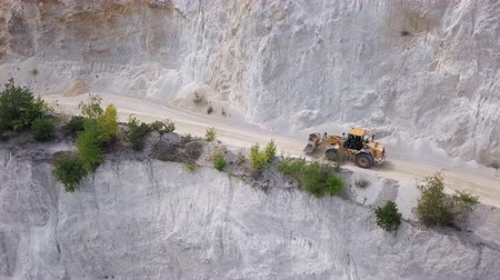 buldozer : Aerial view of bulldozer moving in open air quarry.