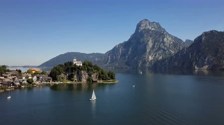 upper peninsula : Flight over Traunkirchen church on Traunsee lake, in Salzkammergut, Upper Austria.