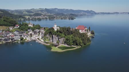 upper peninsula : Flight around Traunkirchen church on Traunsee lake, in Salzkammergut, Upper Austria. Stock Footage