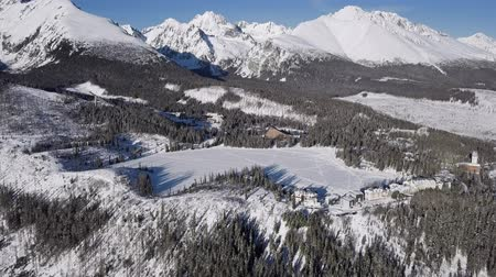 Словакия : Winter aerial view of Strbske Pleso resort in High Tatras mountains, Slovakia. Стоковые видеозаписи