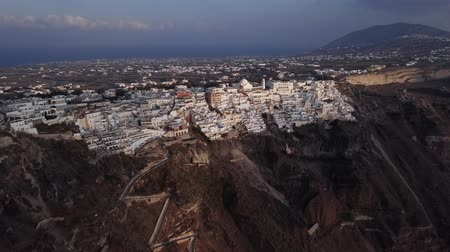 Киклады : Flight over of Fira (Thira) town at sunset, Santorini island, Greece