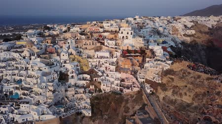УВР : Flight over of Oia town just before sunset, Santorini island, Greece Стоковые видеозаписи