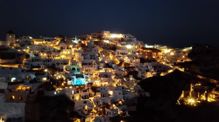 УВР : Flight over of night Oia town on Santorini island, Greece