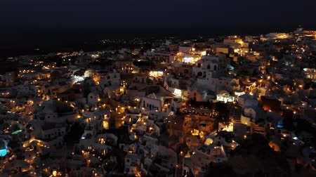 Киклады : Flight over of night Oia town on Santorini island, Greece