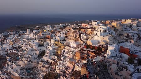 Санторини : Flight over of Oia town just before sunset, Santorini island, Greece Стоковые видеозаписи