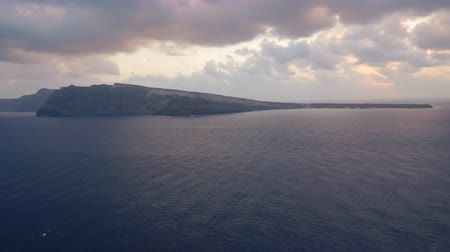 УВР : Time lapse of sunset and tourist boats going to evening trip, near Oia town, Santorini, Greece.
