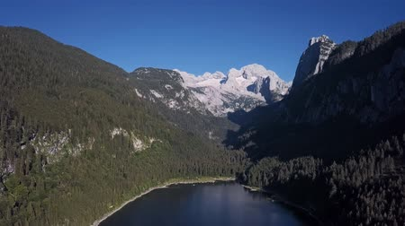 hegytömb : Aerial panorama of Gosaukamm and Dachstein massif, Gosau lake in Salzkammergut, Upper Austria. Stock mozgókép