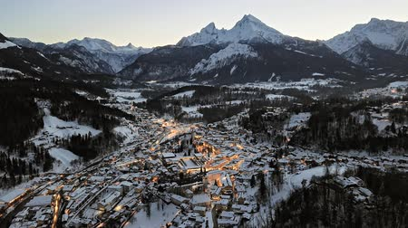 bavorské : Day to night aerial hyper lapse of old town Berchtesgaden covered by winter snow, Bavaria, Germany.