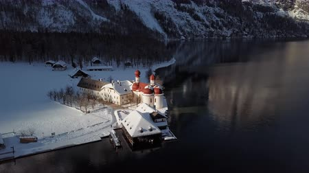 bajor : Winter flight around of St. Bartholomews Pilgrimage church on Konigsee, Berchtesgaden, Germany