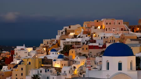 УВР : Night time lapse of Oia town, Santorini island, Greece