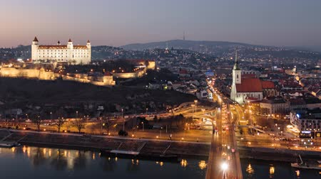 Day to night aerial hyper lapse of Bratislava old town and castle, view from SNP bridge. Slovakia. Stok Video