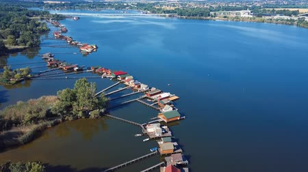 Aerial panorama of traditional fishing houses line on the lake shore, Hungary.