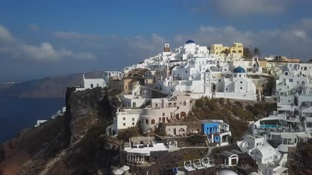 Flight over traditional terraced white villas in Imerovigli village, Santorini, Greece Stok Video