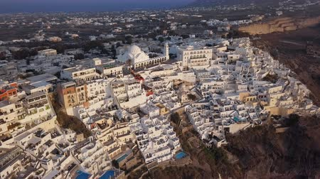 Flight over of Fira (Thira) town at sunset, Santorini island, Greece