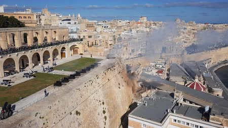 Aerial view of gun shooting on Saluting Battery, Upper Barrakka Gardens in Valletta old town, Malta