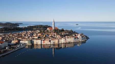 Morning aerial panorama of old town Rovinj, with reflection in the sea. Istria, Croatia. Vídeos