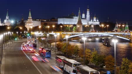 Night hyperlapse of Moscow Kremlin and Moskva river with cruise ships, Russia.