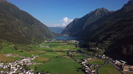 Aerial panorama of Val Poschiavo valley and Lago di Poschiavo lake near Bernina Pass, Graubunden, Switzerland.