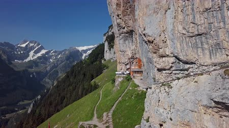 Flight around chalet in the rock on Ebenalp, Canton of Appenzell, Switzerland