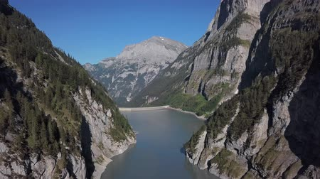 Aerial panorama of narrow mountain lake Gigerwaldsee in the Canton of St. Gallen, Switzerland.