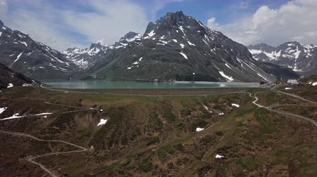 ダム : Flight over of Silvretta-Bielerhohe High Alpine Road and Silvretta Stausee lake in Vorarlberg, Austria.