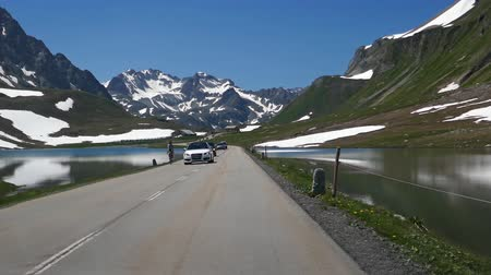 POV car travelling by road on Albula mountain pass, Graubunden, Switzerland. Stok Video