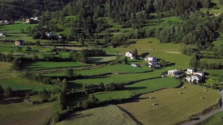 Aerial panorama of rural alpine houses in Val Poschiavo valley near Bernina Pass, Graubunden, Switzerland.