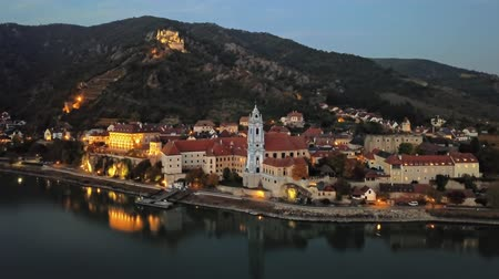 Night aerial hyperlapse panorama of Durnstein town, Wachau valley, Austria.