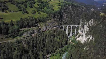 Aerial view of famous Landwasser Viaduct (Landwasserviadukt) and Schmittentobel Viaduct, UNESCO World Heritage, Graubunden, Switzerland.