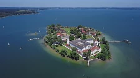 Aerial panorama of Frauenchiemsee island (Fraueninsel) in Chiemsee lake, Bavaria, Germany.