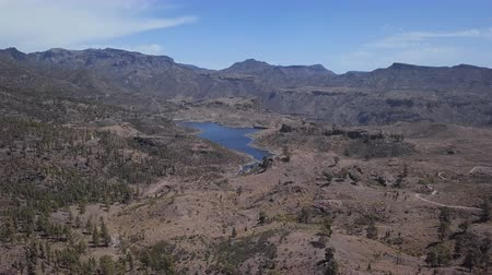 Flight over desert landscape in caldera of Tejeda and Presa de Las Ninas, Gran Canaria, Canary islands, Spain.