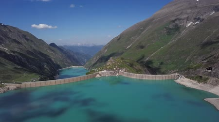 Flight over of Kaprun high mountain reservoirs Mooserboden Stausee and Wasserfallboden in the Hohe Tauern, Salzburger land, Austria.