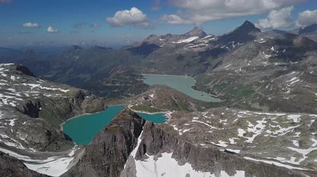 Flight over Weissee and Tauernmoosee alpine lakes in Uttendorf, Salzburger Land, Austria. Stok Video