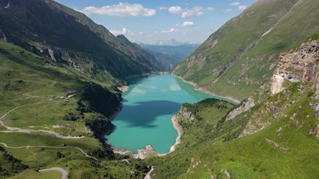 Hyper lapse of Wasserfallboden lake on Kaprun high mountain reservoir Mooserboden Stausee in the Hohe Tauern, Salzburger land, Austria.