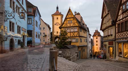 tor : Day to night timelapse of Rothenburg ob der Tauber old town Das Plonlein at Christmas, Bavaria, Germany.