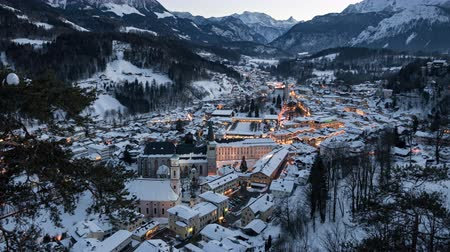 bajor : Day to night aerial time lapse of old town Berchtesgaden covered by winter snow, Bavaria, Germany.