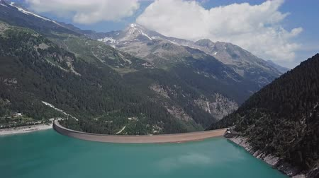 hidro : Flight over of Schlegeis Stausee reservoir dam and panoramic Alpine Road in the Zillertal Alps, Tirol, Austria.
