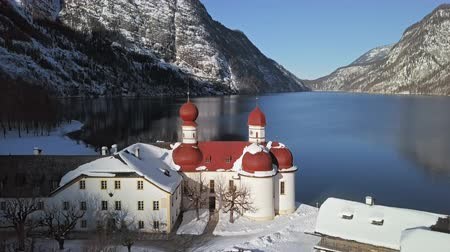 bajor : Winter flight over of St. Bartholomews Pilgrimage church on Konigsee, Berchtesgaden, Germany