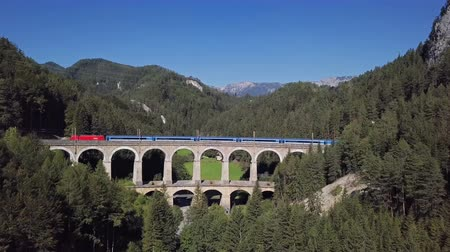 ravina : Aerial view of train rides on famous Kalte Rinne Viaduct on historical Semmering mountain railway (Semmeringbahn), Lower Austria.