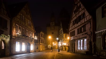 bajor : Early morning time lapse of Rothenburg ob der Tauber old town Weisser Turm at Christmas, Bavaria, Germany. Stock mozgókép