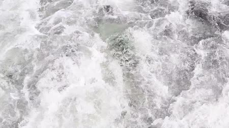 river ocean : Turbulent flow of water after a boat or flowing from river or canal.