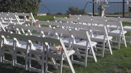 trawnik : white chairs on the grass