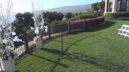 Wedding area with flowers and chairs on the grass
