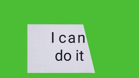 olasılık : Card on green screen with piece blowing away to change text from I cant do it to I can do it