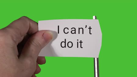 olasılık : Model holding card in front of green screen, then cutting card multiple times to change text from I cant do it to I can do it.