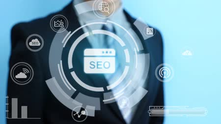 seo : video of business man touch seo icon