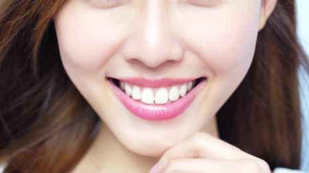зубастая улыбка : video of beauty woman smile happily with health teeth on blue background Стоковые видеозаписи