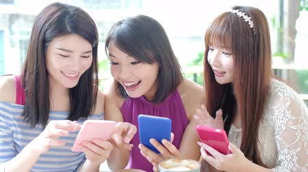 bestie : happy women friends play smart phone in restaurant
